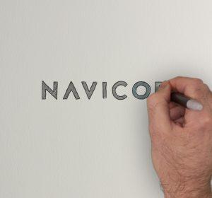 <span>Navicor Explainer Video</span><i>→</i>